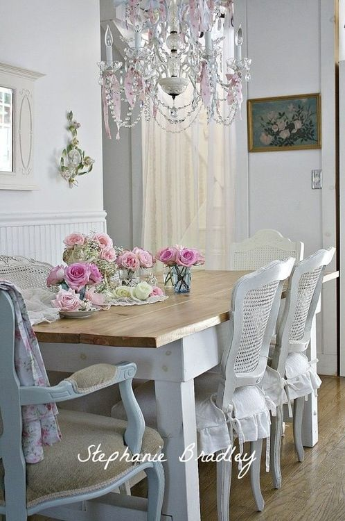 Shabby chic dining room Love the cane chairs and the sweet seat covers!
