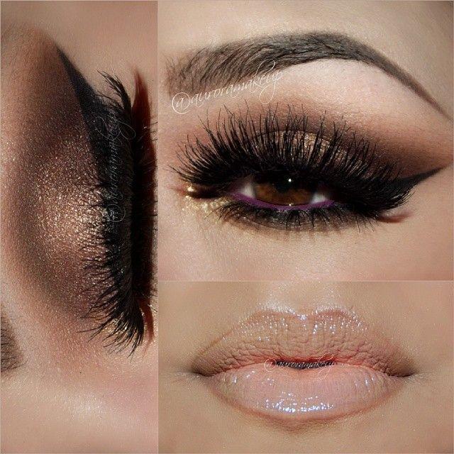 Smokey bronze eye makeup, vibrant purple eyeliner on the waterline (wench look)