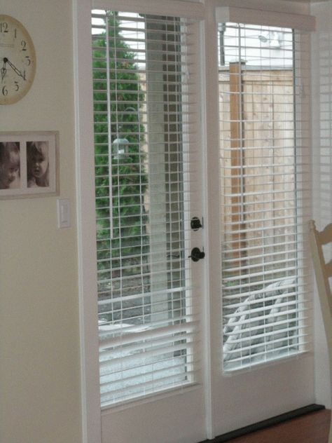 Wood or Faux Wood blinds are another possibility.    They tend to rattle when you open and close the door and are bulkier when raised, but they  mimic the look of costlier plantation shutters at a fraction of the cost.  On a sliding door, they need to be mounted above the door, and a valance or cornice box would be needed to hide the top of the blinds.