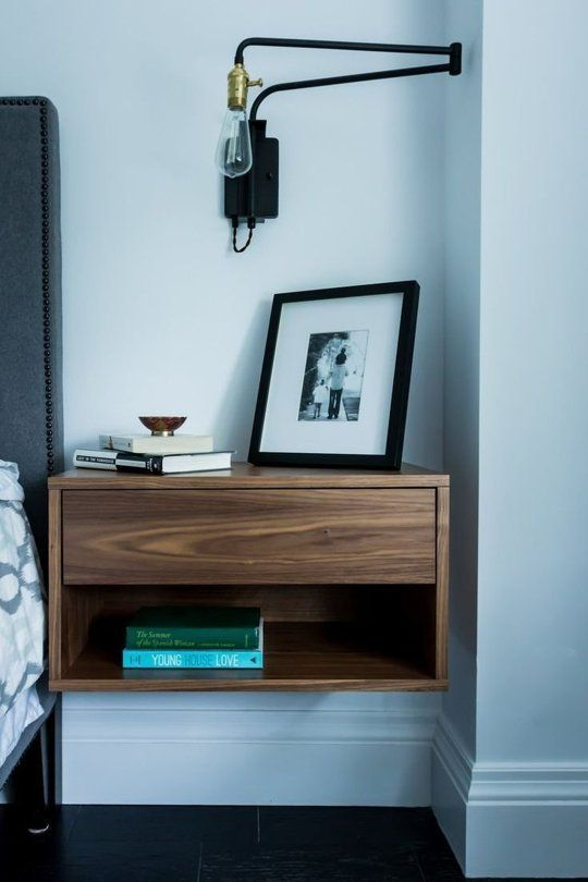 Design Dozen: 12 Clever Space-Saving Solutions for Small Bedrooms 4. A nightstand that mounts on the wall is perfect for a small bedroom. The open space underneath the nightstand visually enlarges the space, and you can also stash things like shoes and books underneath. Mounting a lamp on the wall frees up space on top of the nightstand. via ApartmentTherapy