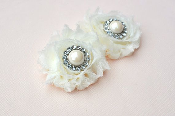 So simple and stunning! Shoe clip are perfect for all occasions,specially for bride and bridesmaids. ♥ Ivory Flower with Rhinestone Pearl Center ♥ Set of 2 ♥ Easy clips On *********** Ready to ship **************** ::::Designed and handmade by TangCreations::::: See my shop for more pieces for bride, bridesmaid, and flower girl: http://www.etsy.com/shop/TangCreations?ref=ss_profile Terms and Conditions of Sale, Payment terms, Shipping terms, and Return Policy...