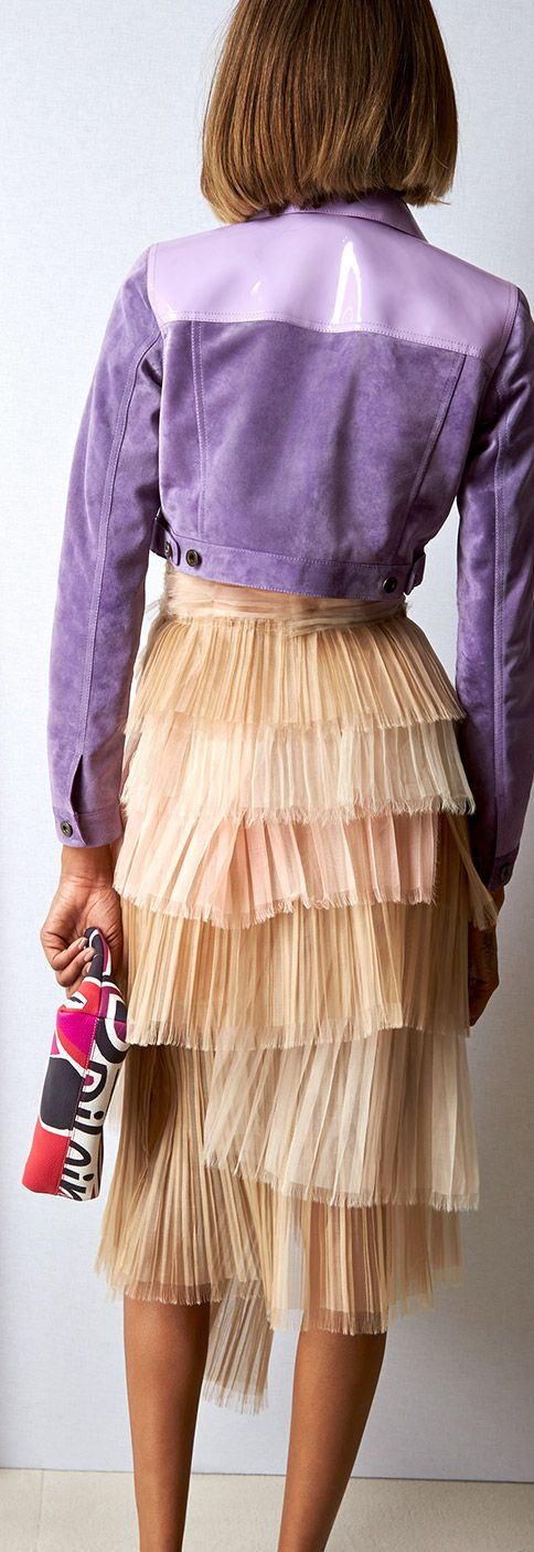 A cropped suede and patent leather jacket in lavender with a cobweb tulle dress in pale rose