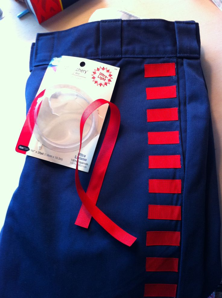 quick & inexpensive Han Solo pants. blue work pants, grosgrain ribbon attached with stitch witchery for stripes.