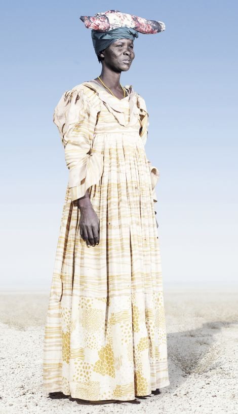 Herero woman in yellow dress:
