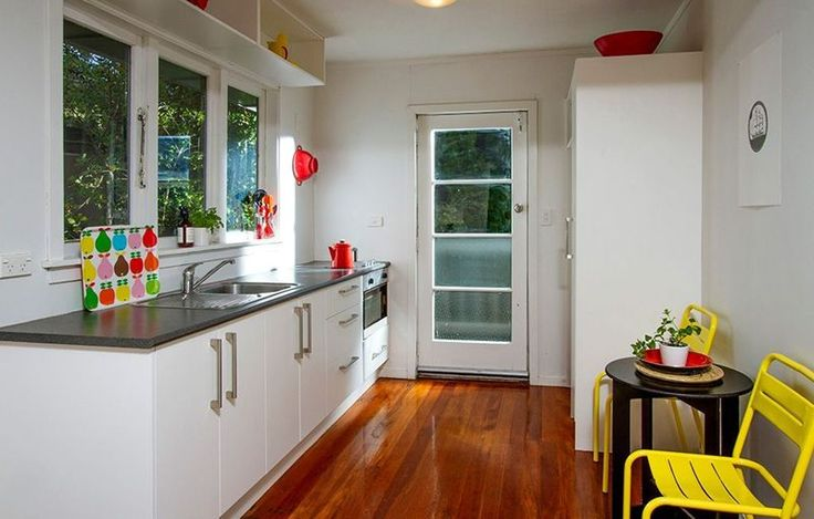 #red highlights #bright sprint kitchen #yellow chairs. Styling by places and graces. Photo courtesy of @Harcourts State Office