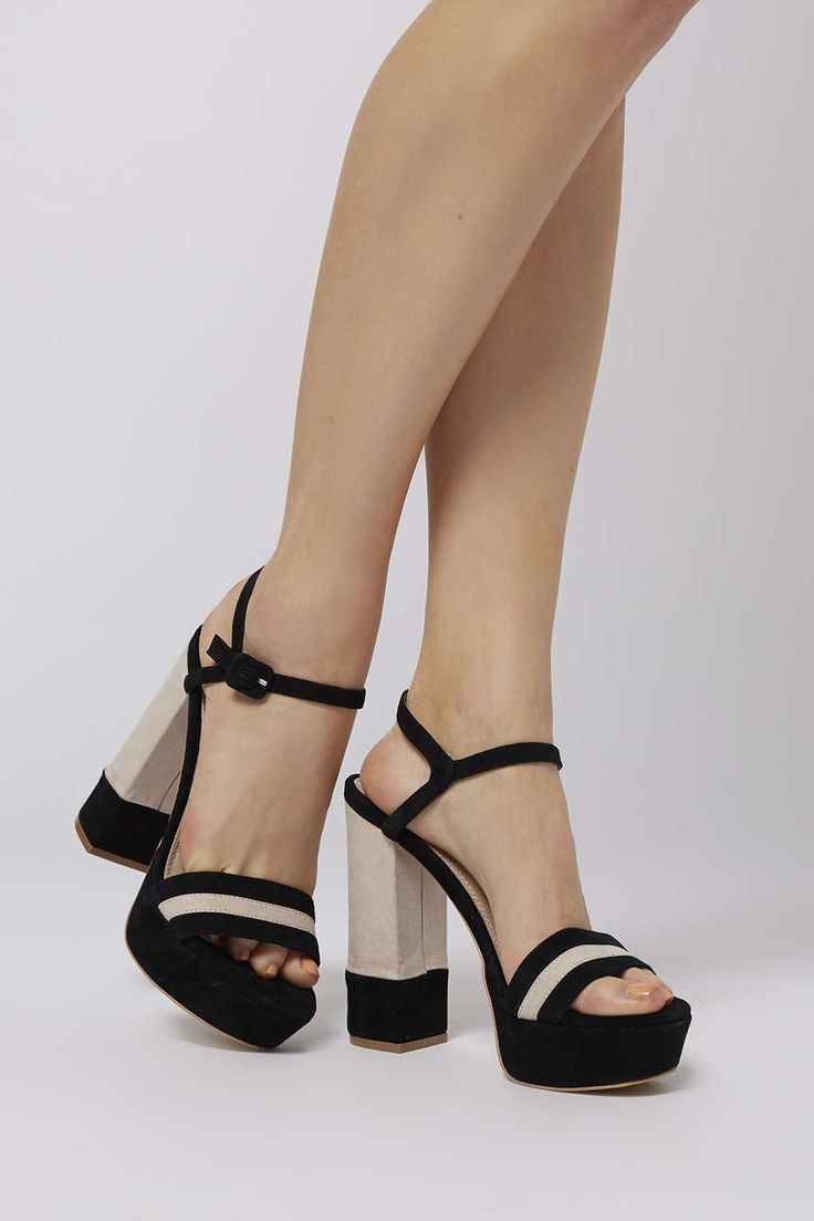 Slip feet into a wearable, dressy heel like this colour blocked platform. Shaped with a comfortable platform and a flared heel, they come in a trending monochrome colour with an adjustable buckle fastening and a peeptoe front. #Topshop
