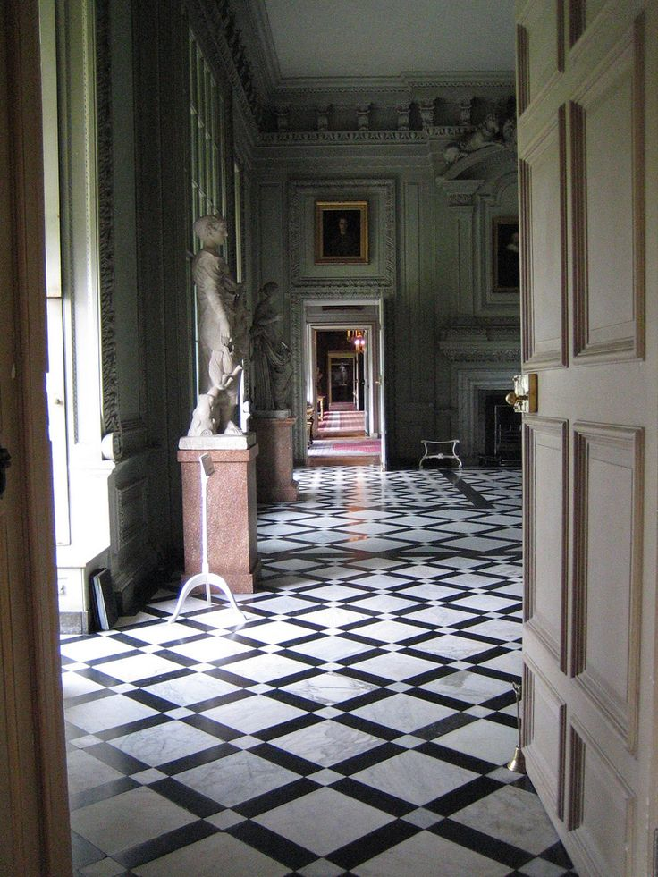 The diamond pattern in a black and white marble floor - I would do this pattern in all white marble (no black)