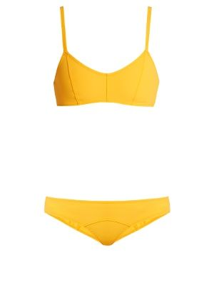 Arriving in a marigold-orange hue, Lisa Marie Fernandez's classic Genevieve bikini is destined for sun-soaked vacations. Crafted from the label's innovative bonded stretch fabric, the sporty-cut top has flattering bonded sides and secures simply with a black buckle, while the briefs are cut for a low rise to elongate the silhouette. Maximise the effortless vibes with a pair of mirrored sunglasses when lounging by the pool.