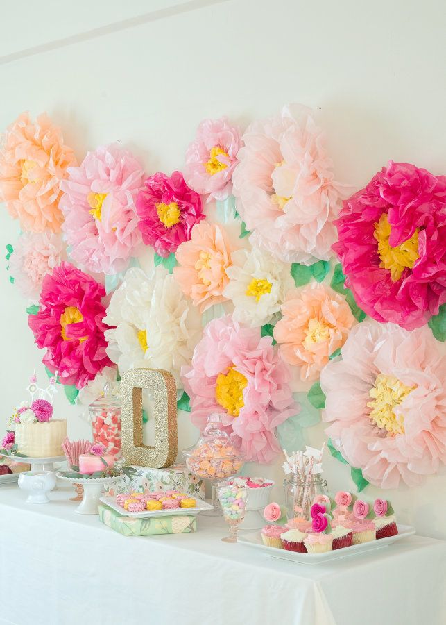 Colorful tissue paper floral backdrop: http://www.stylemepretty.com/living/2015/11/13/garden-party-first-birthday/ | Photography: Modern Kids - http://www.modernkids.com/