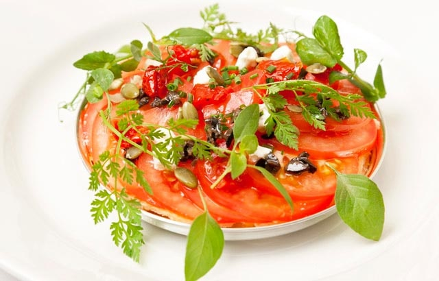 Baked tomato galette with goats cheese, tapenade and pumpkin seeds - Andy Waters