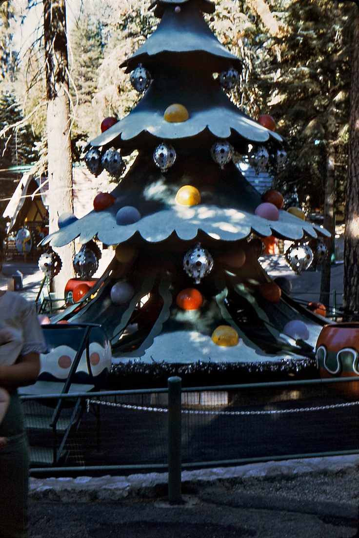 Christmas tree ride at Santa's Village in Skyforest, San Bernardino County, California.  Sit in an oversized Christmas tree ball and go around the tree and up and down.