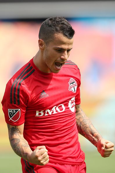 Sebastian Giovinco of Toronto FC celebrates after scoring a goal to make it 22 during the MLS match between Toronto FC and New York City FC at Yankee...