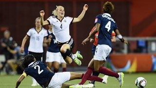 Leonie Maier of Germany is challenged by Wendie Renard of France
