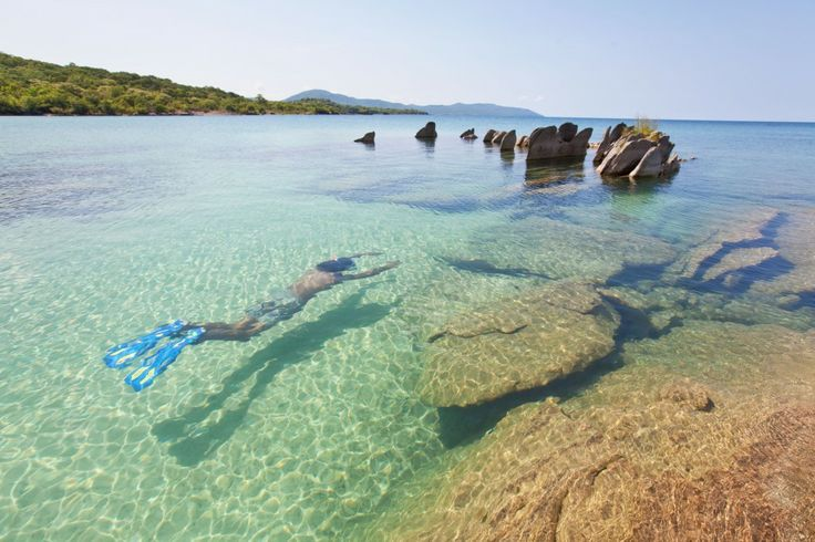 Swimming in the crystal clear waters of Lake Niassa, Mozambique