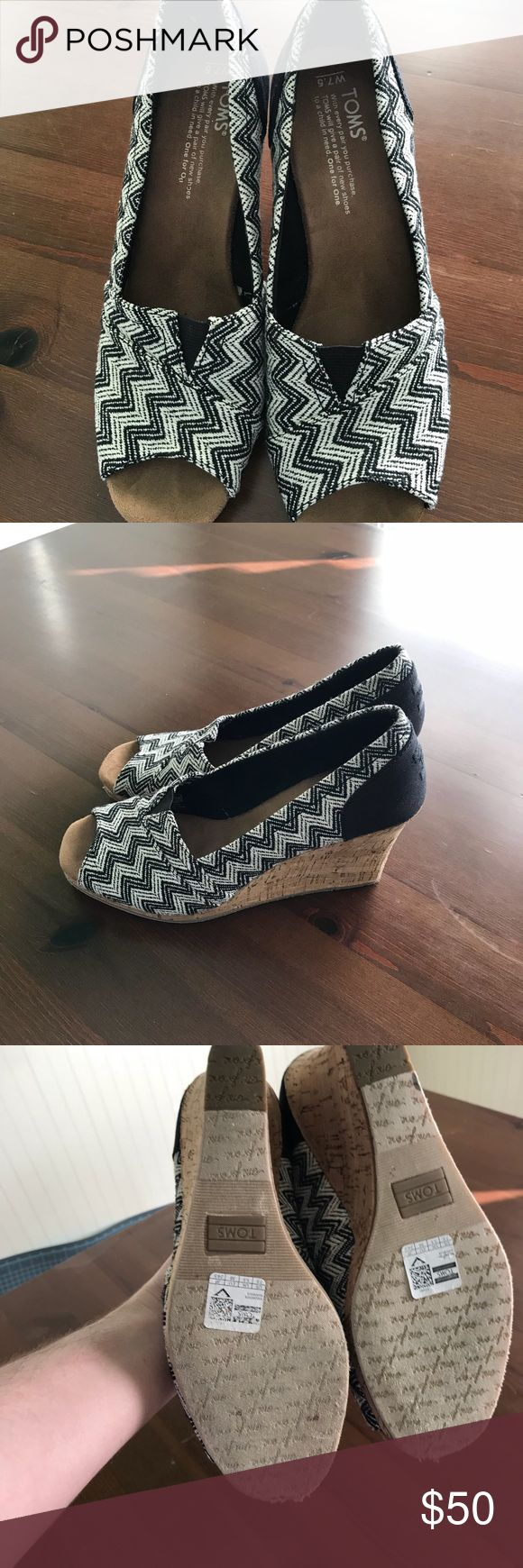 Black and White Chevron Toms Cute wedges in black and white chevron, barely worn as can be seen by the bottoms. Toms Shoes
