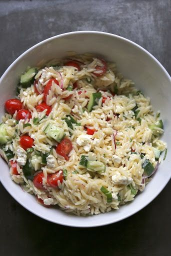 It's Not Summer Yet Greek Pasta Salad With Olive Oil, Fresh Lemon Juice, Shallots, Dijon Mustard, Honey, Sea Salt, Cracked Black Pepper, Orzo Pasta, English Cucumber, Cherry Tomatoes, Feta Cheese Crumbles, Purple Onion, Fresh Basil, Sea Salt, Cracked Black Pepper
