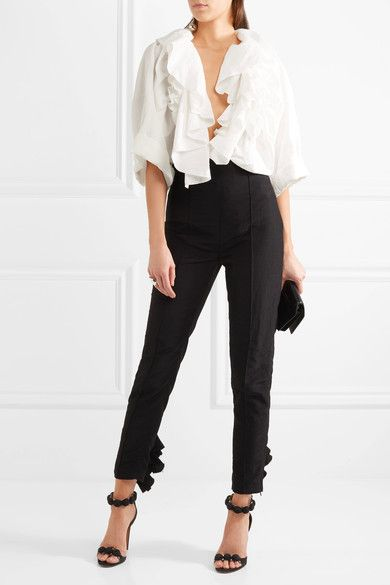 Exaggerated ruffles are a defining theme for Carmen March's Spring '17 collection. Reminiscent of '80s styles, this blouse is cut from white taffeta that is defined by folded cuffs and lightly frayed trims. Style yours as a blouse for the office or try it for evening as a jacket.