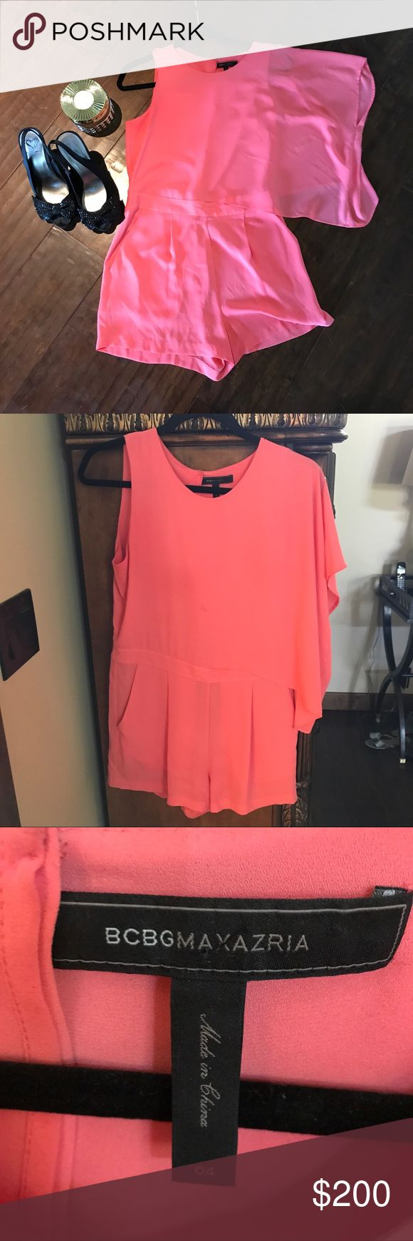 Coral Chiffon BCBG Romper This coral chiffon BCBG Romper is perfect for the summer!! It is chiffon material and the longer sleeve on one side is a big trend this season! Size 4! Can be worn for a fancy brunch or a cute pair of flats for day wear!! BCBGMaxAzria Pants Jumpsuits & Rompers