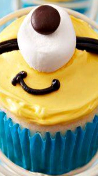 Despicable Me Minion™ Cupcakes. Black writers pen or Black shoelace.  marshmallow , m&m or chocolate chip for eyeball.