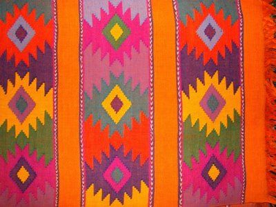 The textiles are handwoven by Maya Indians of Guatemala
