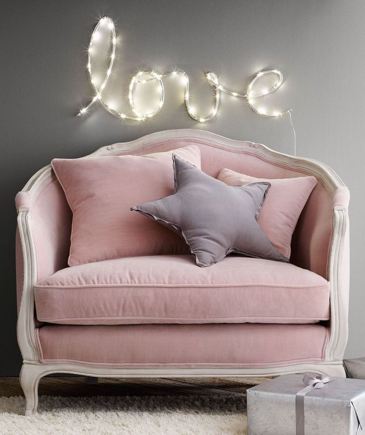 Gorgeous big comfy pink chair with grey star cushion. Really cosy mini sofa. Beautiful love wall light making it the perfect place to sit and read