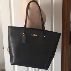 Classic Black Coach Tote Purse In mint condition. Purchased summer 2015, and only used for a couple months. One of my favorite bags, still debating on whether to sell. Will sell if the price is right. Coach Bags Totes