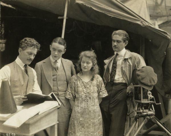 Mae Marsh & Robert Harron with director John Noble & cameraman George Hill on the set of Sunshine Alley, 1917.