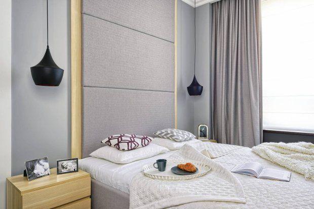 Nowoczesna sypialnia utrzymana w delikatnych szarościach.