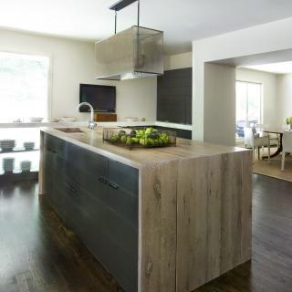 Beautiful modern kitchen. Love the waterfall island countertop. designed by Bill Ingram