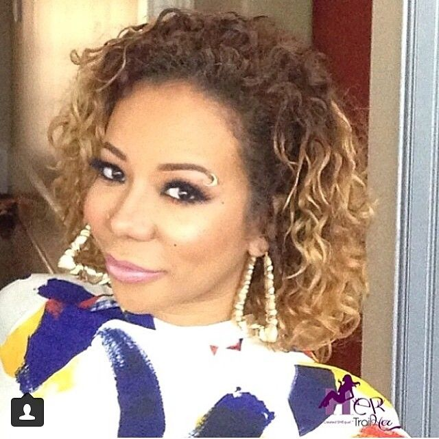 "Tameka ""Tiny"" Cottle curly hair"