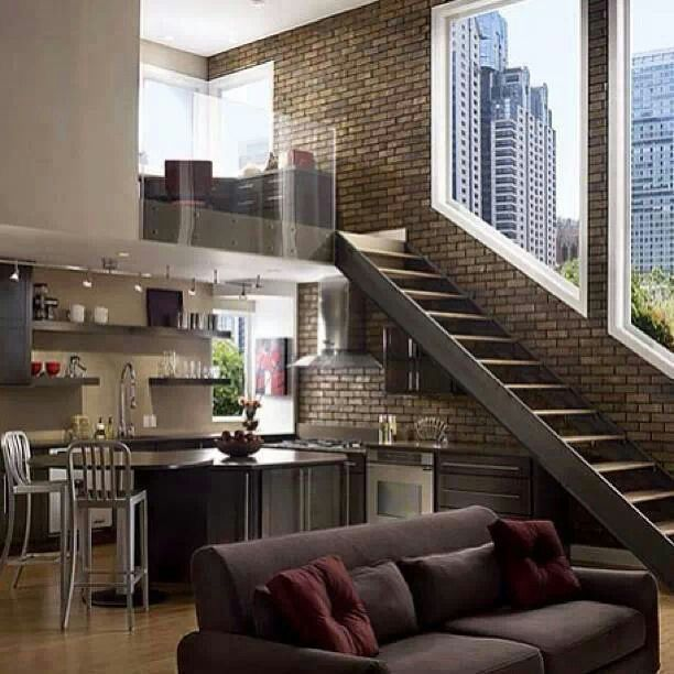 Loft Space above kitchen, flows into living with brick wall and nice stairs
