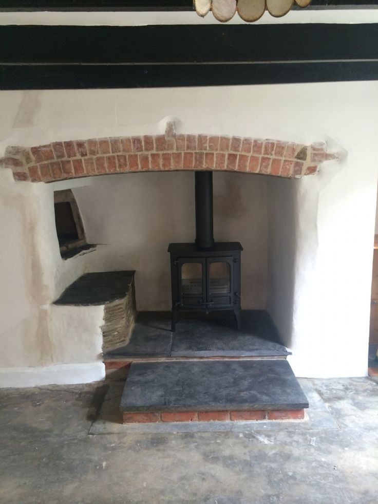 The Charnwood Island is perfect for this situation.  The double doors create a traditional style but the clean lines gives it a modern twist. Installed by Kernow Fires in Cornwall.  #charnwood #island #stove #fire #woodburner #multifuel #traditional #fireplace #hearth #kernowfires #wadebridge #redruth #cornwall