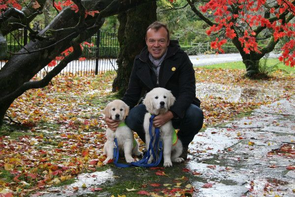 Two of our puppies with our fabulous patron at Irish Dogs for the Disabled, Graham Norton