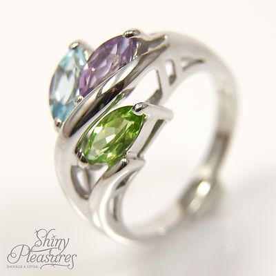 INTRIGUING Amethyst, Peridot & Blue Topaz Tri-colour Genuine Sterling Silver Ring. The synergy of the three coloured gemstones in this unique piece is sure to compliment almost any outfit in your wardrobe - $37.99 with FREE worldwide shipping.