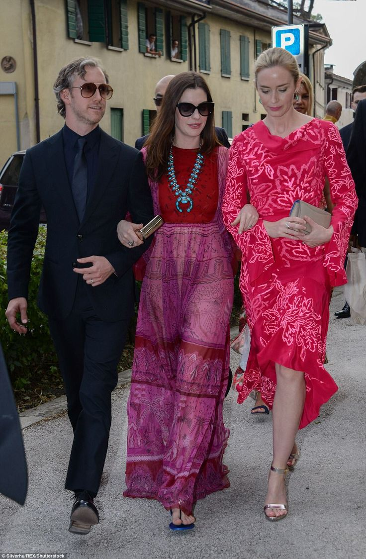 Star-studded:Anne Hathaway, 34, was a guest, linking arms with her husband, Adam Shulman, 36, and her The Devil Wears Prada co-star Emily Blunt, 34