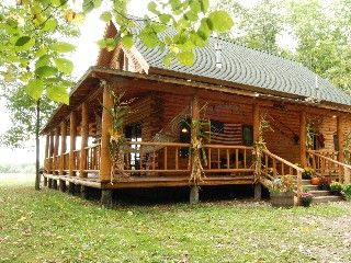 Beautiful log cabin near lake mountain views home movie for Log cabin homes with wrap around porch