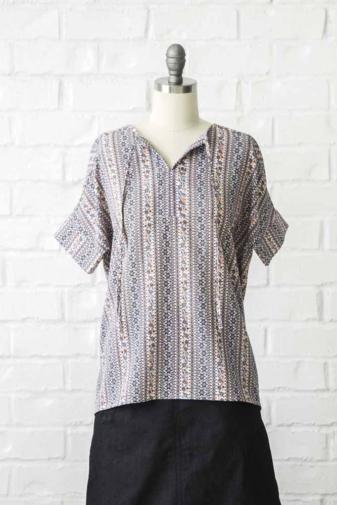 ba3e8d1647bdb Our easy to wear tie neck top comes in fun multi colored pattern. This  modest comfy top features short sleeves.97% Polyester3% SpandexLength  26.3
