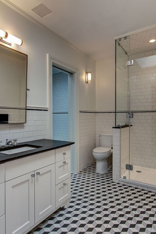 this bathroom turns to whitewashed fixtures and subway tiles wall sconces and glass fixtures to