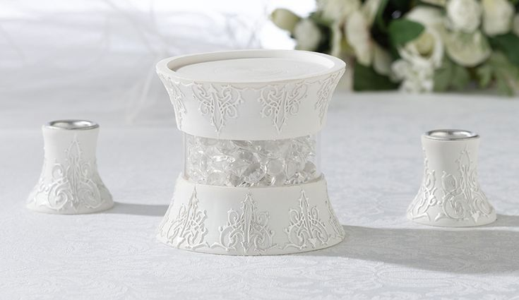 "- This beautiful 3"" and 1.5"" three piece white resin and crystals candle holder set will complement any ceremony or table. Set includes one unity holder and two taper holders"