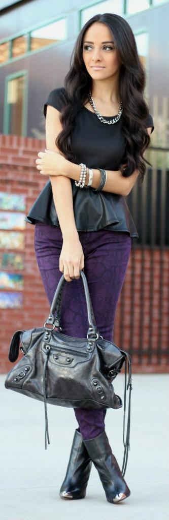 Black peplum top with purple snakeskin printed skinnies