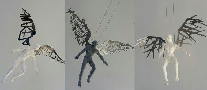 'Awaken Conscious, Planner of the year & Sticks collector' mild steel wings with polyurethane cast bodies by Rudolf Bitzer