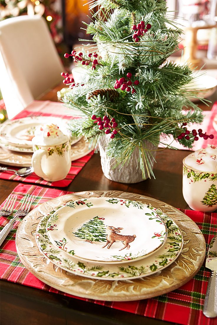 Featuring a deer nibbling at an evergreen, this salad plate coordinates beautifully with Pier 1's heirloom-worthy Winter's Wonder pattern. Crafted of solid ironstone, it features a border of holiday greenery and red holly berries, setting the tone for a traditional Christmas tablescape.