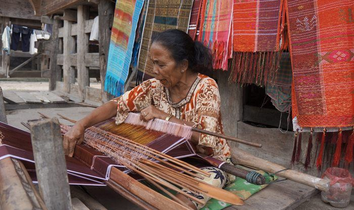 Cultural ties: Local women weave the traditional fabric ulos in Lumban Suhi-suhi Village, Samosir. (Photo by Edna Tarigan)