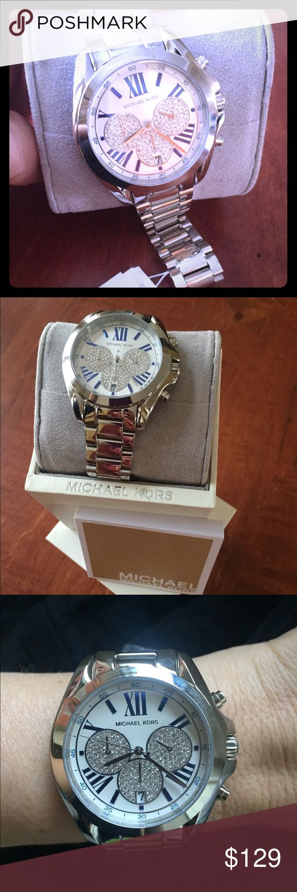 Michael Kors silver watch Gorgeous Roman numeral Michael Kors watch. Silver with white face and blue Roman numerals. Has number date at the 6 pm position. Three crystal plated small watch faces on face as well. You'll love it! Michael Kors Accessories Watches