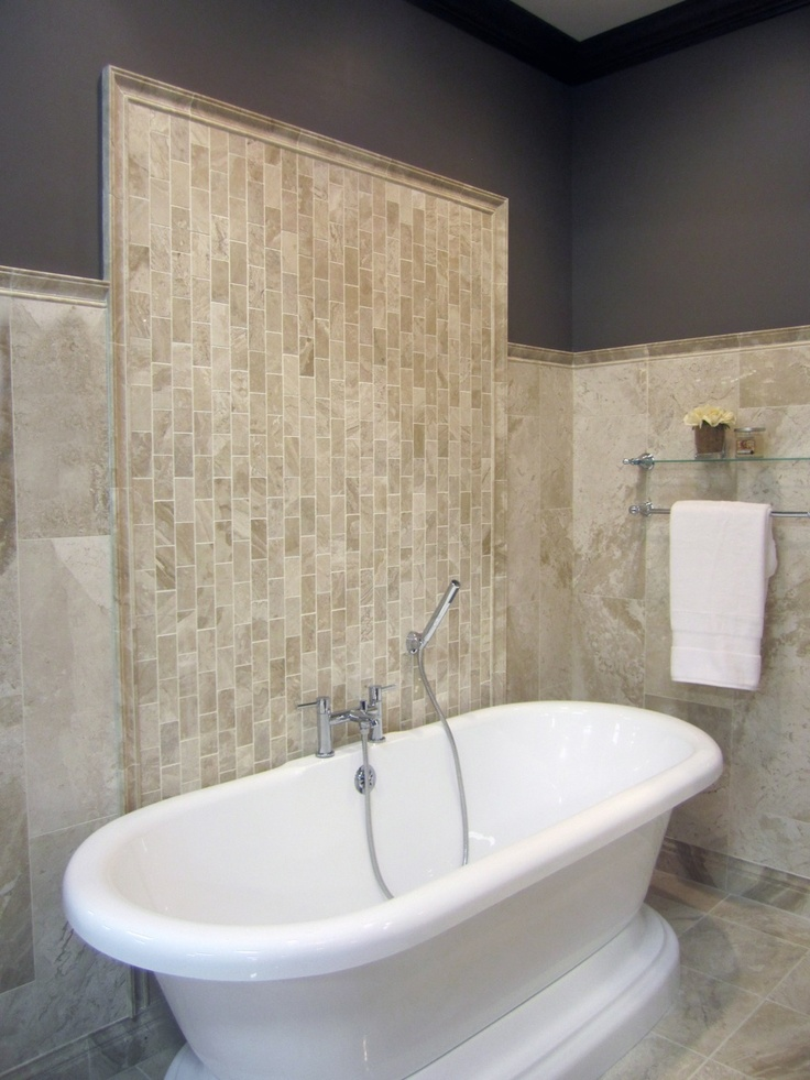 A Vertical Travertine Subway Tile Pattern Bathroom