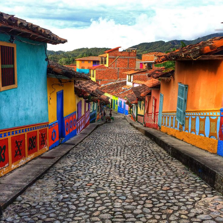 Colombia travel at its finest - The beautiful town of Guatape in Colombia with it's colourful streets