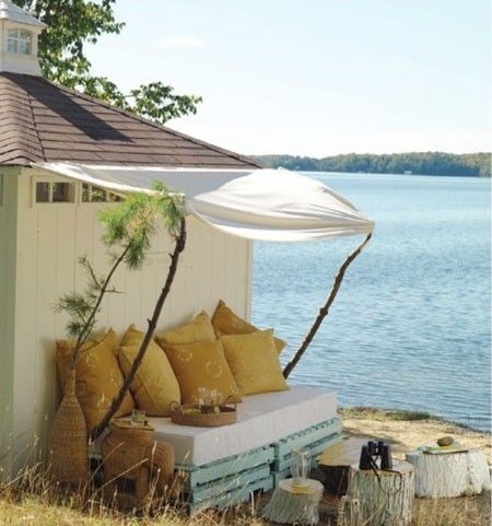Neat way to give the outside of a beach house a comfort lift by adding a pallet beach bed.