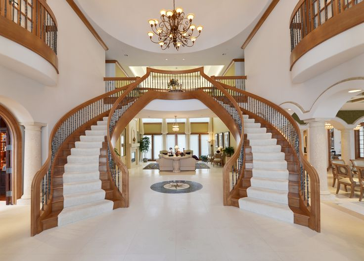 Dual staircase in grand foyer luxury homes pinterest for Double curved staircase