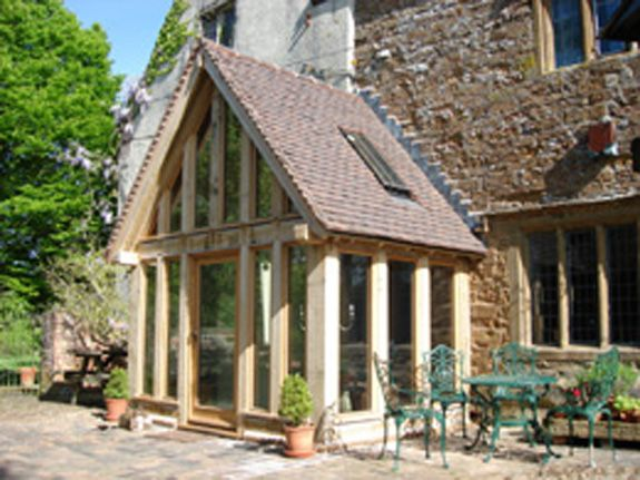 Oak Framed Garden Room/glass with tile-covered porch