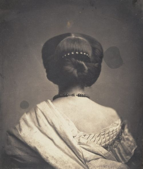 A regally elegant Victorian hairstyle captured on film ca. 1890